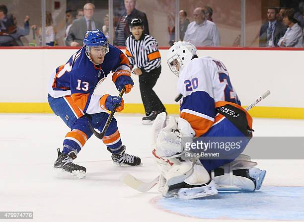 Anthony Pupplo stops Mathew Barzal in the 2015 New York Islanders Blue White Rookie Scrimmage Skills Competition at the Barclays Center on July 8...