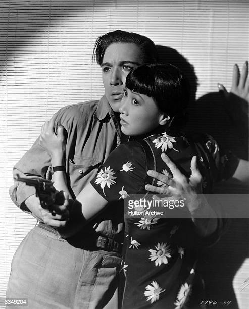Anthony Quinn and Anna May Wong in a scene from the Paramount film 'Island Of Lost Men'