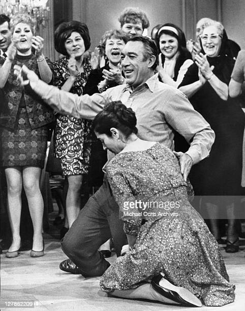 Anthony Quinn and Irene Papas join in a traditional joyful Greek dance in a scene from the film 'A Dream of Kings' 1969