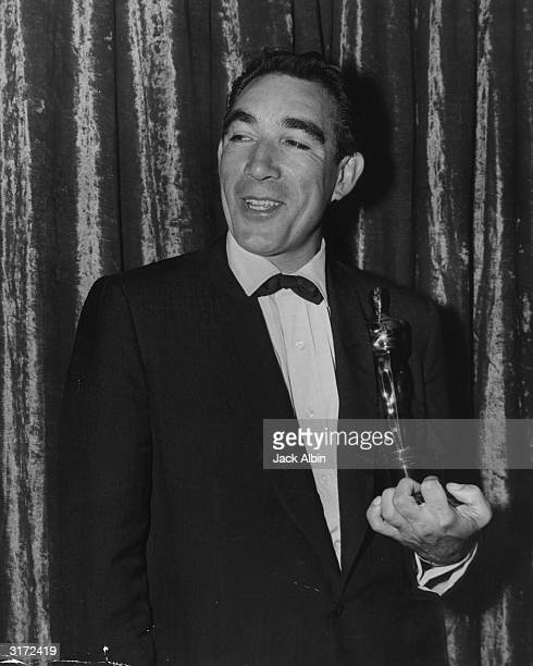 Anthony Quinn holding his Oscar for Best Supporting Actor for his role in director Vincente Minnelli's film 'Lust for Life' Los Angeles California He...