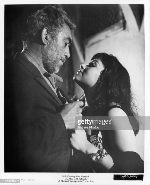 Anthony Quinn looking down into the eyes of Irene Papas in a scene from the film 'Zorba The Greek' 1964