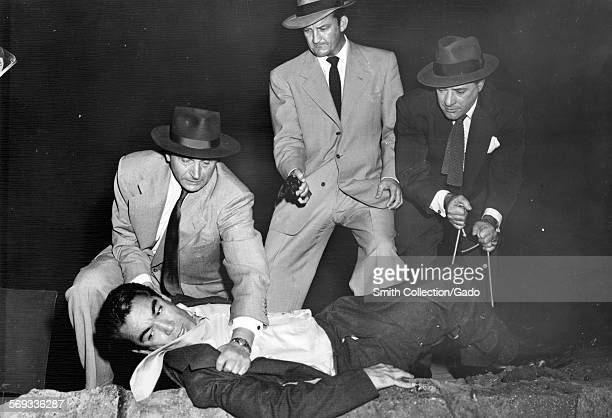 Anthony Quinn plays Johnny McBride in a scene from the film The Long Wait where a group of thugs hold him down 1954