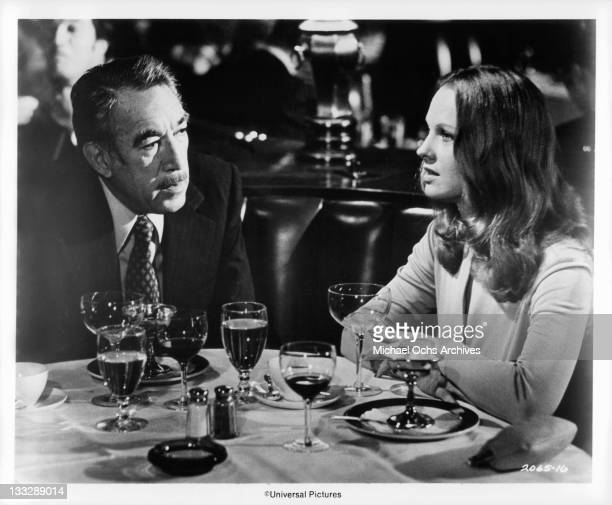 Anthony Quinn promises Angel Tompkins to further her singing career in a scene from the film 'The Don Is Dead' 1973