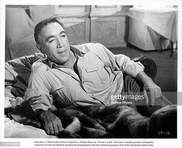 Anthony Quinn relaxing on couch in a scene from the film 'Lost Command' 1966