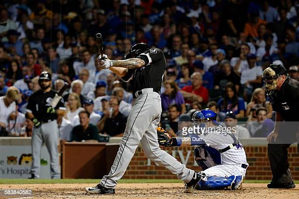 Anthony Ranaudo of the Chicago White Sox hits a one run home run against the Chicago Cubs dumpire Dale Scott at Wrigley Field on July 27 2016 in...