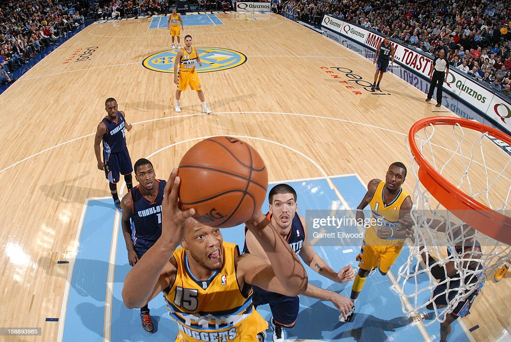 Anthony Randolph #15 of the Denver Nuggets goes to the basket against Byron Mullens #22 of the Charlotte Bobcats on December 22, 2012 at the Pepsi Center in Denver, Colorado.