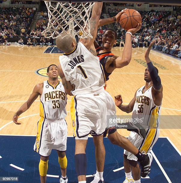 Anthony Randolph of the Golden State Warriors battles Dahntay Jones and Danny Granger of the Indiana Pacers at Conseco Fieldhouse on November 11 2009...