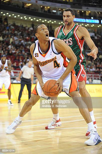 Anthony Randolph of the Golden State Warriors makes a move against Bard Gadzuric of the Milwaukee Bucks during the game at the Beijing Olympic...