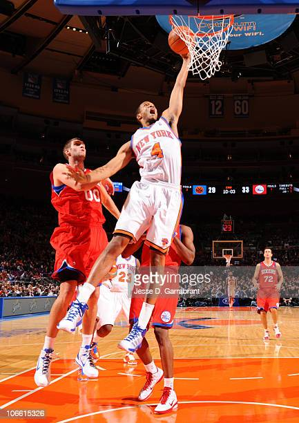 Anthony Randolph of the New York Knicks dunks against Spencer Hawes of the Philadelphia 76ers during the game on November 7 2010 at Madison Square...