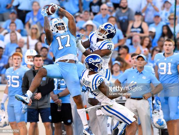 Anthony RatliffWilliams of the North Carolina Tar Heels makes a catch against Alonzo Saxton II and Mark Gilbert of the Duke Blue Devils during their...