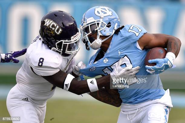 Anthony RatliffWilliams of the North Carolina Tar Heels tries to avoid a tackle by Tra Hardy of the Western Carolina Catamounts at Kenan Stadium on...