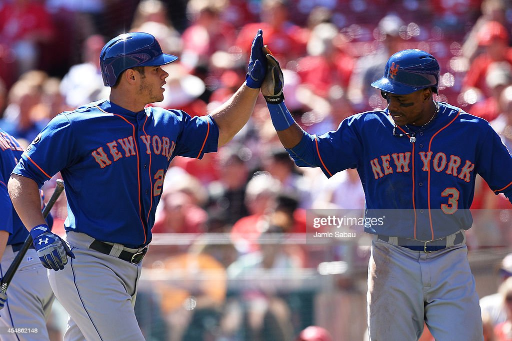 Anthony Recker #20 of the New York Mets and Curtis Granderson #3 of the New York Mets celebrate after they both scored in the sixth inning off a two-run home run from Recker against the Cincinnati Reds at Great American Ball Park on September 7, 2014 in Cincinnati, Ohio.