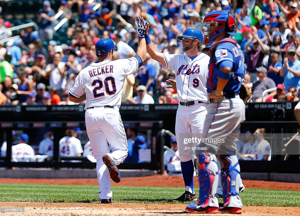 Anthony Recker #20 of the New York Mets celebrates his first inning three-run home run against the Texas Rangers with teammate Kirk Nieuwenhuis #9 at Citi Field on July 6, 2014 in the Flushing neighborhood of the Queens borough of New York City.