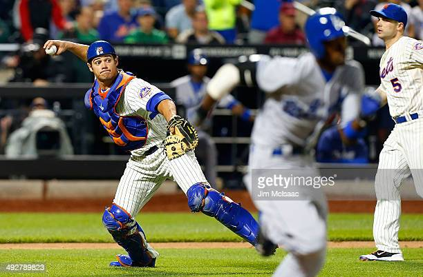 Anthony Recker of the New York Mets throws out Dee Gordon of the Los Angeles Dodgers in the eighth inning at Citi Field on May 21 2014 in the...