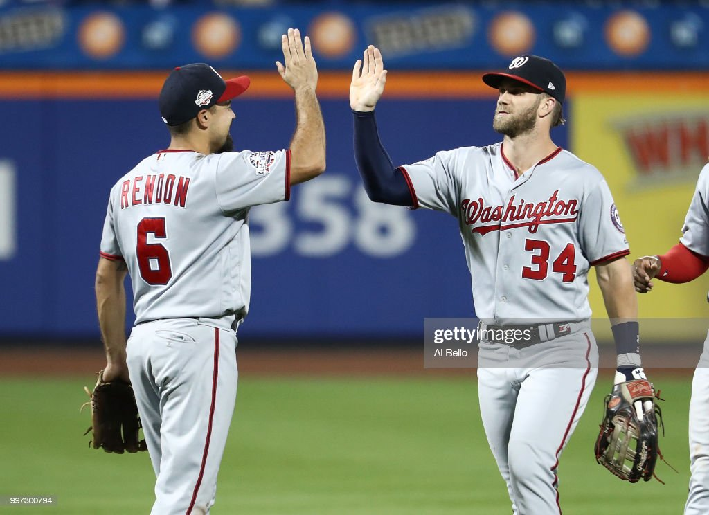 Anthony Rendon #6 and Bryce Harper #34 of the Washington Nationals celebrate a 5-4 win against the New York Mets during their game at Citi Field on July 12, 2018 in New York City.