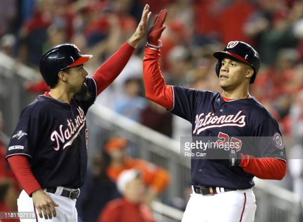Anthony Rendon and Juan Soto of the Washington Nationals celebrate scoring on a two run RBI double by Howie Kendrick of the Washington Nationals...