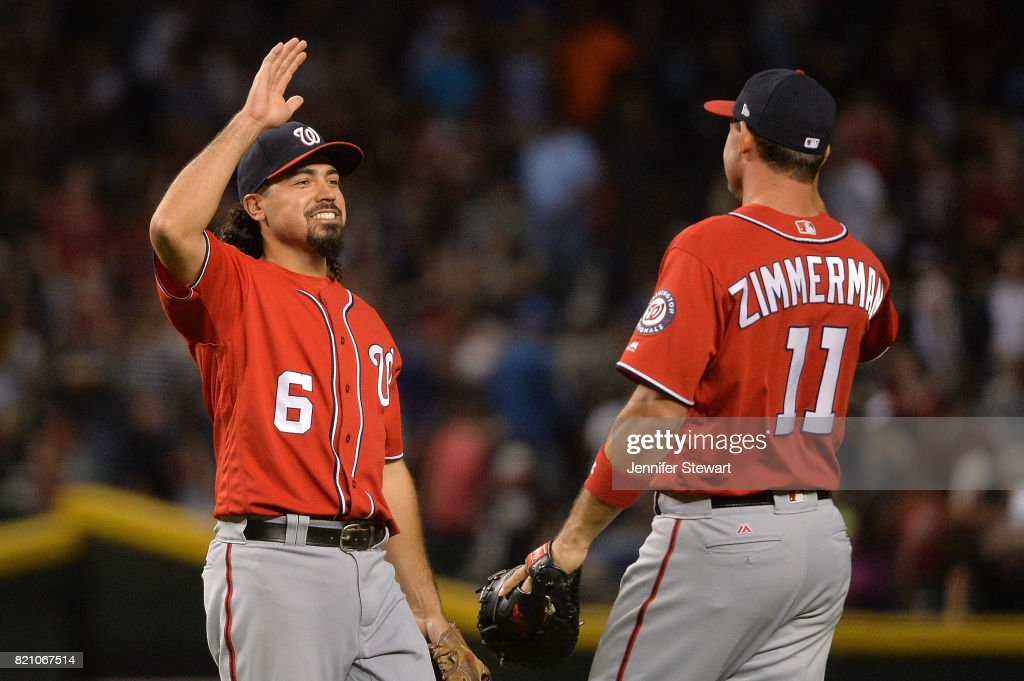 Anthony Rendon #6 and Ryan Zimmerman #11 of the Washington Nationals celebrate after closing out the game against the Arizona Diamondbacks at Chase Field on July 22, 2017 in Phoenix, Arizona. The Washington Nationals won 4-3.