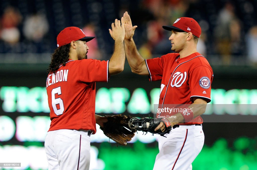 Anthony Rendon #6 and Ryan Zimmerman #11 of the Washington Nationals celebrate after a 3-1 victory against the San Francisco Giants at Nationals Park on August 12, 2017 in Washington, DC.
