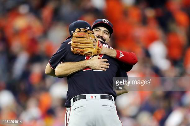 Anthony Rendon and Ryan Zimmerman of the Washington Nationals celebrate their teams 72 win against the Houston Astros in Game Six of the 2019 World...