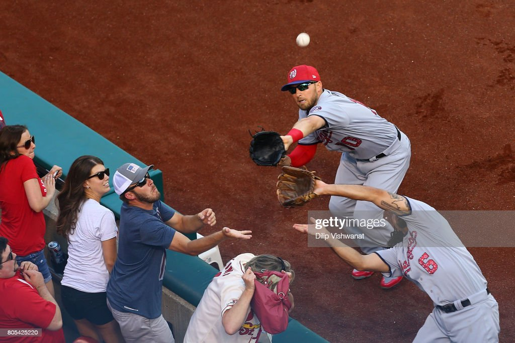 Anthony Rendon #6 and Stephen Drew #10 of the Washington Nationals attempt to catch a pop foul against the St. Louis Cardinals in the first inning at Busch Stadium on July 1, 2017 in St. Louis, Missouri.