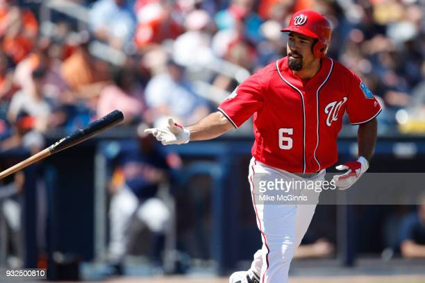 Anthony Rendon of the Houston Astros throws the bat after drawing a walk during the second inning of the Spring Training game against the Washington...