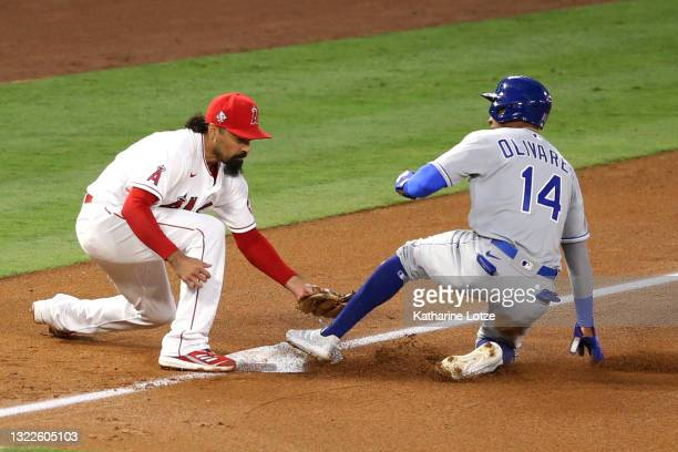 Anthony Rendon of the Los Angeles Angels tries to tag Edward Olivares of the Kansas City Royals out at third base during the fifth inning at Angel...