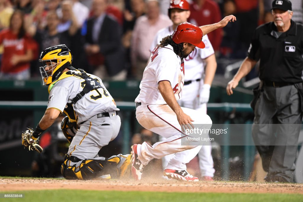 Anthony Rendon #6 of the Washington Nationals beats the tag by Elias Diaz #32 of the Pittsburgh Pirates on a triple by Alejandro De Aza #17 of the Washington Nationals in the seventh inning during a baseball game at Nationals Park on September 28, 2017 in Washington, DC.