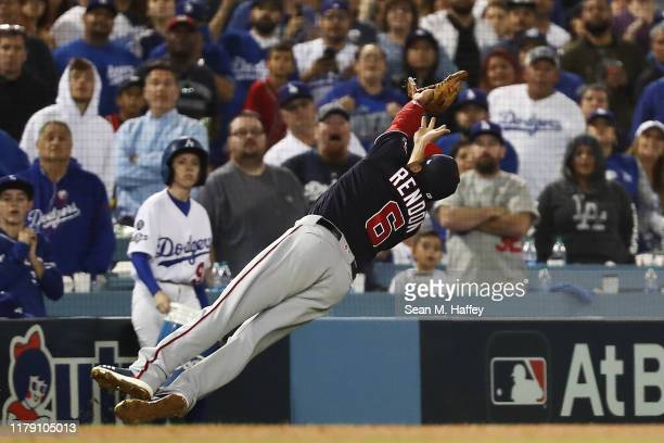 Anthony Rendon of the Washington Nationals catches a fly ball hit by Cody Bellinger of the Los Angeles Dodgers in the ninth inning in game two of the...