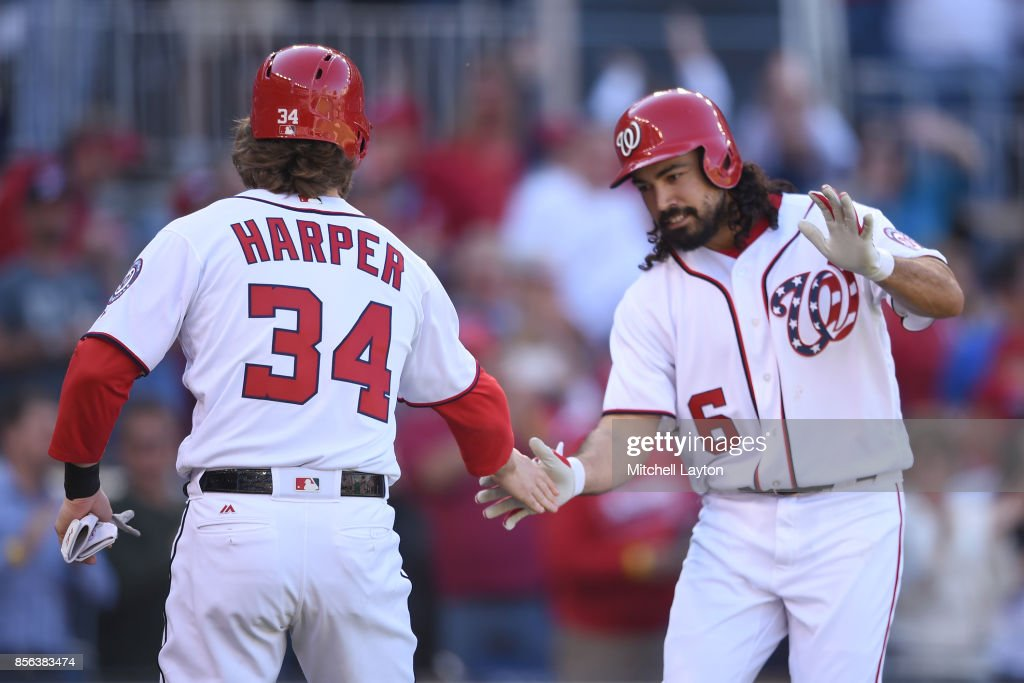 Anthony Rendon #6 of the Washington Nationals celebrates hitting a three run home run in the first inning with Bryce Harper #34 during a baseball game against the Pittsburgh Pirates at Nationals Park on October 1, 2017 in Washington, DC.