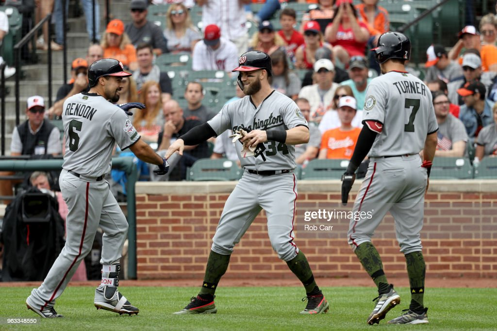 Anthony Rendon #6 of the Washington Nationals celebrates with Bryce Harper #34, and Trea Turner #7 after driving them in with a three RBI home run against the Baltimore Orioles in the third inning at Oriole Park at Camden Yards on May 28, 2018 in Baltimore, Maryland. MLB players across the league are wearing special uniforms to commemorate Memorial Day.