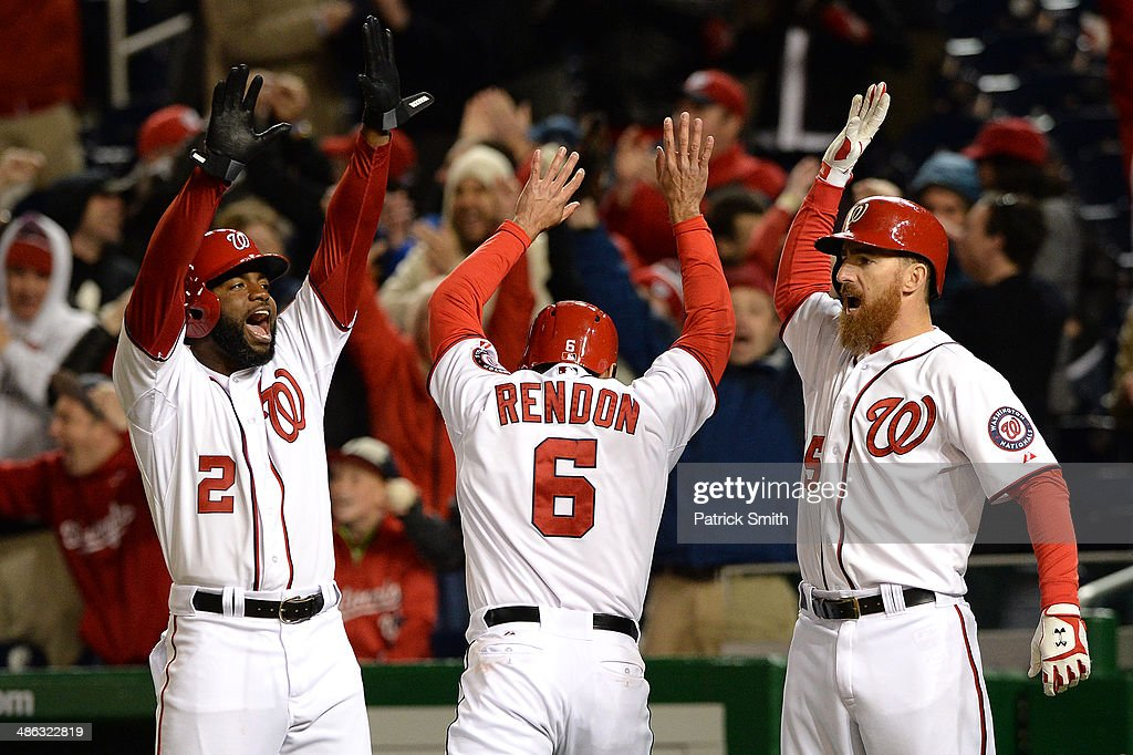 Anthony Rendon #6 of the Washington Nationals celebrates with Denard Span #2 and Adam LaRoche #25 after scoring the tying run off of a Jayson Werth RBI double in the ninth inning against the Los Angeles Angels of Anaheim at Nationals Park on April 23, 2014 in Washington, DC. The Washington Nationals won, 5-4.