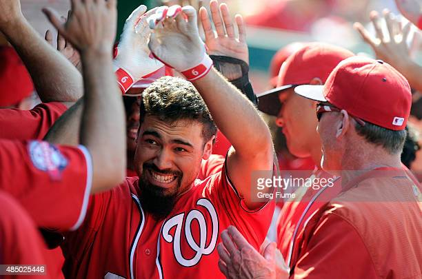 Anthony Rendon of the Washington Nationals celebrates with teammates after hitting a threerun home run in the fifth inning against the Milwaukee...