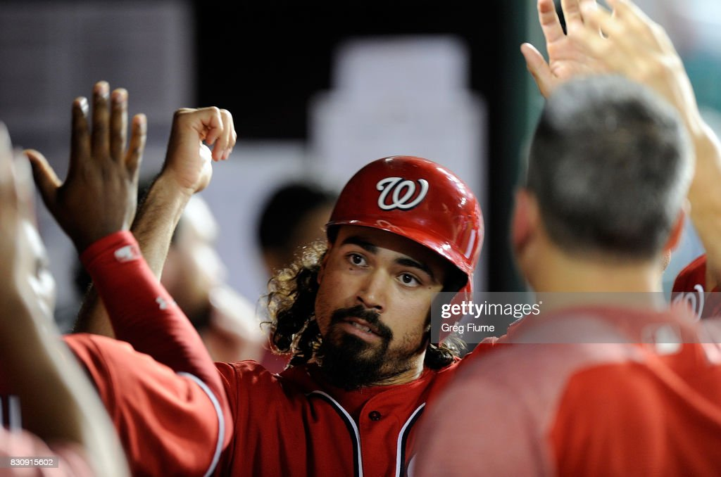 Anthony Rendon #6 of the Washington Nationals celebrates with teammates after scoring in the sixth inning against the San Francisco Giants at Nationals Park on August 12, 2017 in Washington, DC.