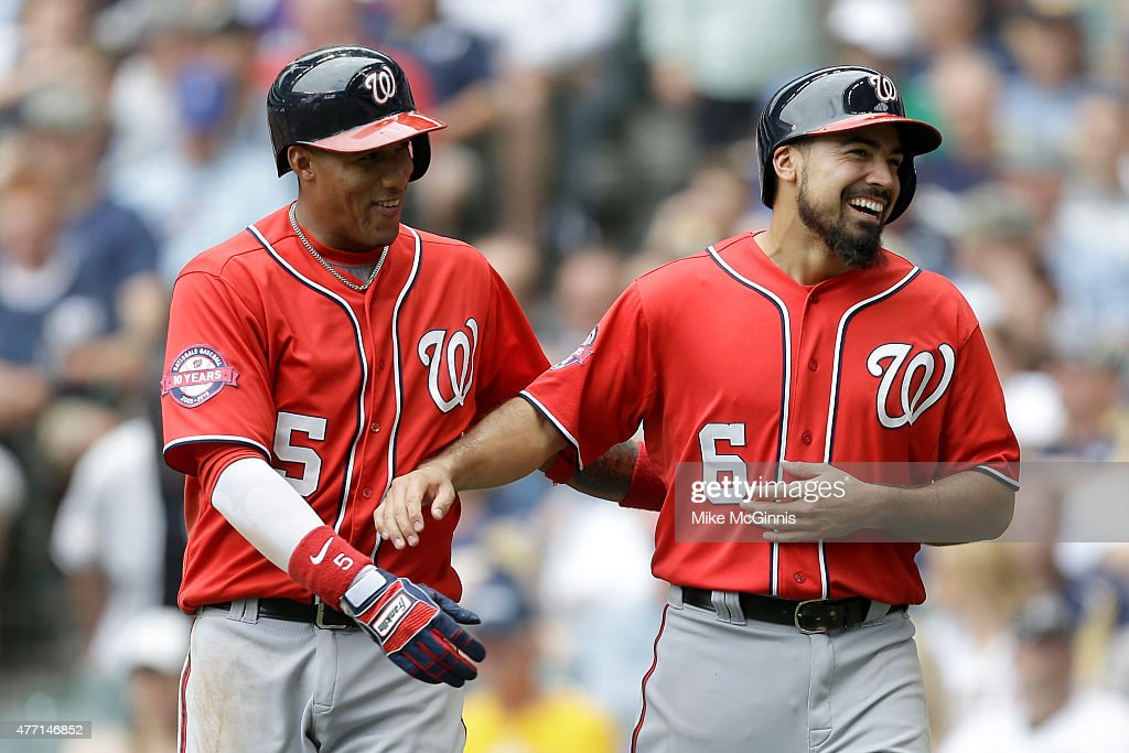 Anthony Rendon #6 of the Washington Nationals celebrates with Yunel Escobar #5 celebrate after reaching on a RBI double hit by Clint Robinson during the seventh inning against the Milwaukee Brewers at Miller Park on June 14, 2015 in Milwaukee, Wisconsin.