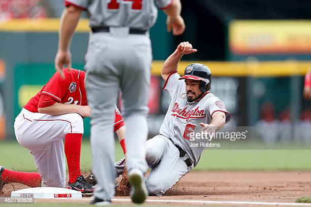Anthony Rendon of the Washington Nationals gets tagged out at third base on a fielder's choice in the first inning of the game against the Cincinnati...