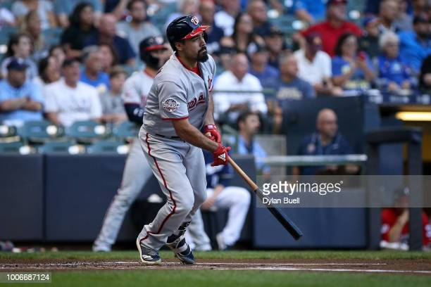 Anthony Rendon of the Washington Nationals hits a single in the first inning against the Milwaukee Brewers at Miller Park on July 23 2018 in...