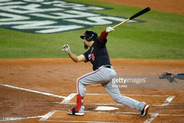 Anthony Rendon of the Washington Nationals hits a two-RBI double against the Houston Astros during the first inning in Game Two of the 2019 World...