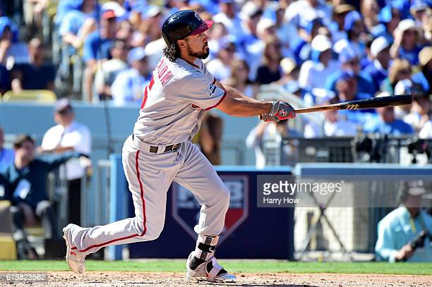Anthony Rendon of the Washington Nationals hits a tworun home run in the third inning against the Los Angeles Dodgers in game three of the National...