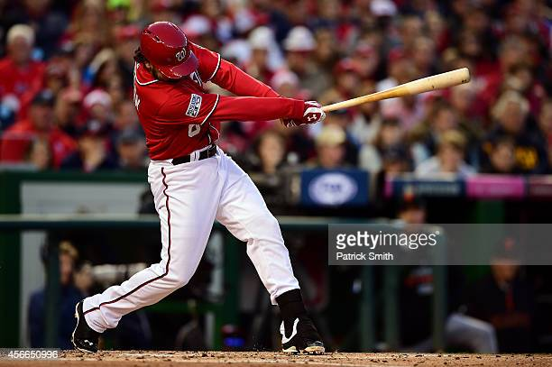 Anthony Rendon of the Washington Nationals hits an RBI single to left field to score Asdrubal Cabrera in the third inning against Tim Hudson of the...