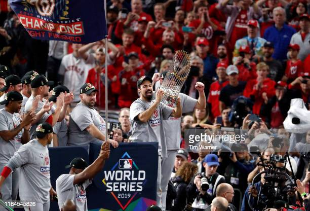 Anthony Rendon of the Washington Nationals hoists the Commissioners Trophy after defeating the Houston Astros 62 in Game Seven to win the 2019 World...