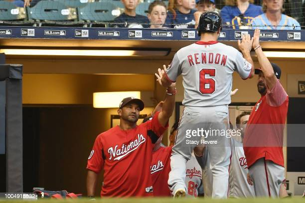 Anthony Rendon of the Washington Nationals is congratulated by teammates after scoring a run during the first inning of a game against the Milwaukee...