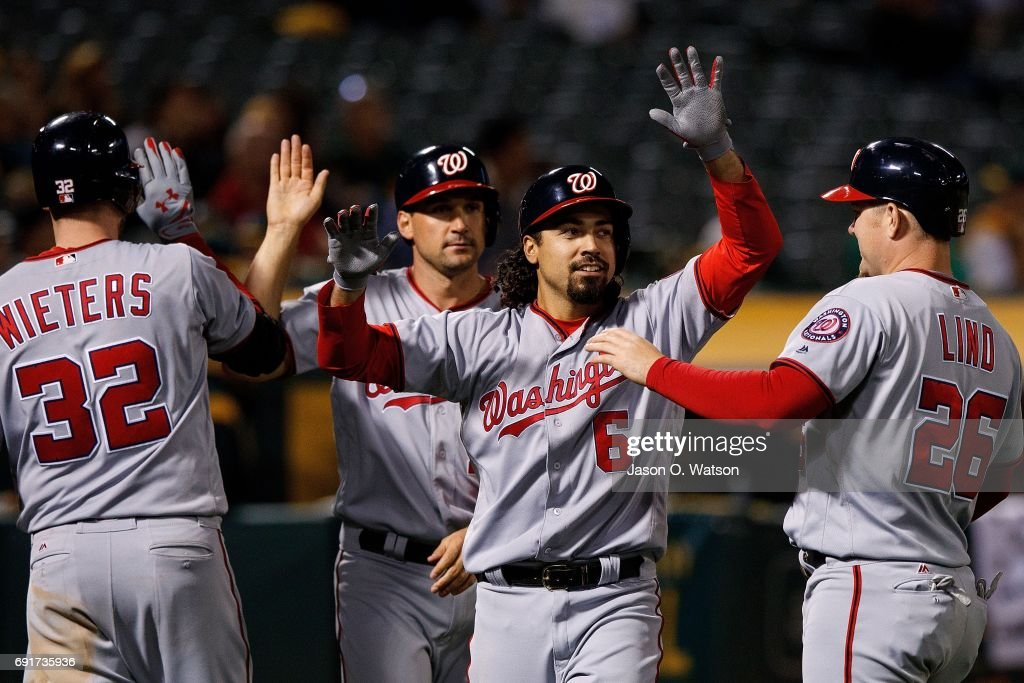 Anthony Rendon #6 of the Washington Nationals is congratulated by teammates after hitting a three run home run against the Oakland Athletics during the eighth inning at the Oakland Coliseum on June 2, 2017 in Oakland, California. The Washington Nationals defeated the Oakland Athletics 13-3.