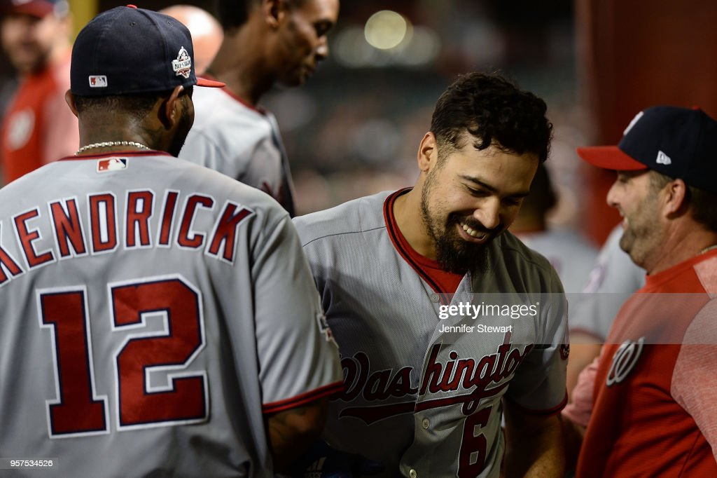 Anthony Rendon #6 of the Washington Nationals is congratulated by Howie Kendrick #12 after hitting a solo home run in the eighth inning of the MLB game against the Arizona Diamondbacks at Chase Field on May 11, 2018 in Phoenix, Arizona. The Washington Nationals won 3-1.