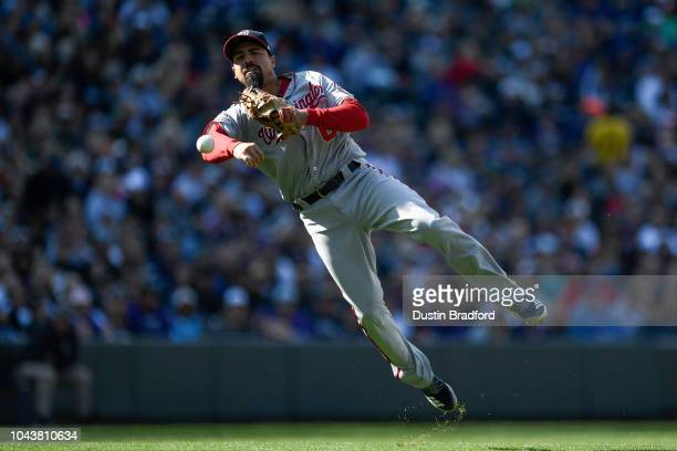 Anthony Rendon of the Washington Nationals makes a leaping throw for a forceout during a game against the Colorado Rockies at Coors Field on...