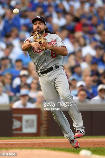 Anthony Rendon of the Washington Nationals makes a throw to first base during game three of the National League Divisional Series against the Chicago...