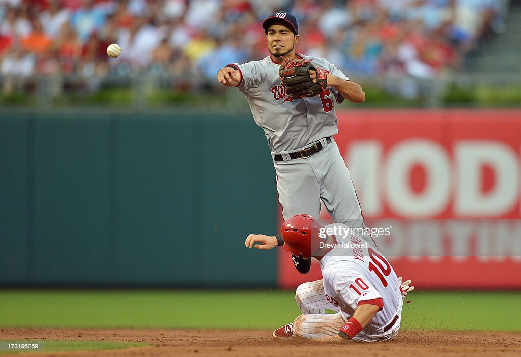 Anthony Rendon #6 of the Washington Nationals puts out Michael Young #10 of the Philadelphia Phillies at second base while turing a double play in the second inning at Citizens Bank Park on July 9, 2013 in Philadelphia, Pennsylvania.