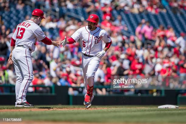 Anthony Rendon of the Washington Nationals rounds the bases after hitting a home run against the Philadelphia Phillies during the first inning at...