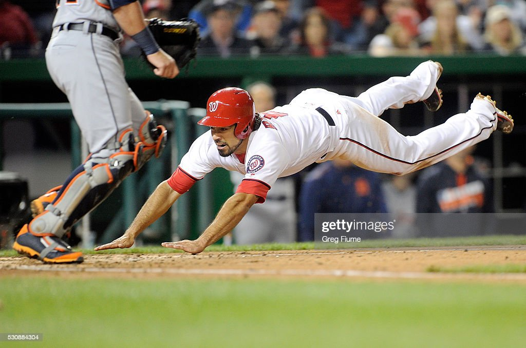Anthony Rendon #6 of the Washington Nationals slides into home plate and scores in the sixth inning against the Detroit Tigers at Nationals Park on May 11, 2016 in Washington, DC. Washington won the game 3-2.