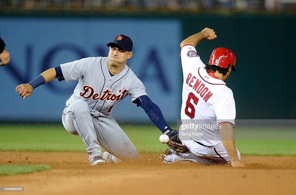Anthony Rendon #6 of the Washington Nationals steals second base in the sixth inning as the throw gets away from Jose Iglesias #1 of the Detroit Tigers at Nationals Park on May 11, 2016 in Washington, DC.