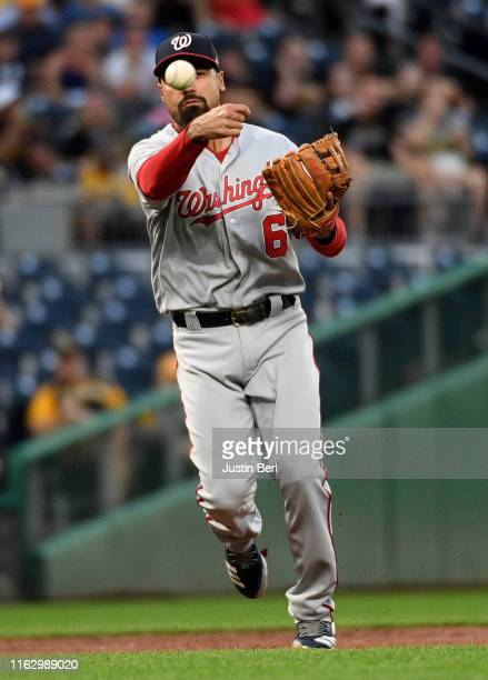 Anthony Rendon of the Washington Nationals throws to first base to force out Starling Marte of the Pittsburgh Pirates in the fourth inning during the...